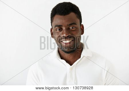 Headshot Of Happy African American Student Wearing White T-shirt Looking And Smiling At The Camera A
