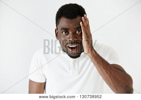 Headshot Of Handsome Surprised African American Young Man Looking At The Camera, Astonished With Big