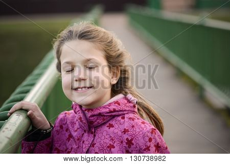 happy girl portrait with closed eyes on fresh windy air