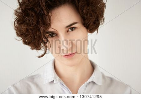 Close Up Shot Of Young Brunette Caucasian Woman Looking With Serious Expression At The Camera. Portr