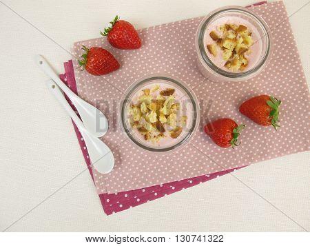 Homemade strawberry cheesecake shake with cake crumbs