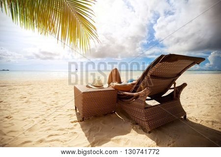 Relax on sunbeds on peaceful beach, holiday and vacation