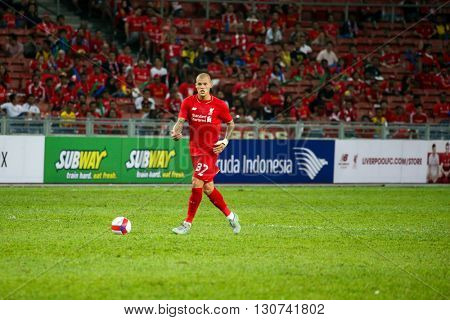 July 24, 2015- Shah Alam, Malaysia: Liverpool's Martin Skrtel dribbles the ball in a friendly match against the Malaysian Team. Liverpool Football Club from England is on an Asia tour.