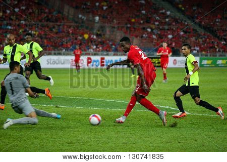 July 24, 2015- Shah Alam, Malaysia: Liverpool's Dovock Origi (27) shoots at goal in a friendly match against the Malaysian Team. Liverpool Football Club from England is on an Asia tour.