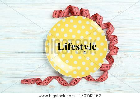 Yellow plate on a blue wooden table, lifestyle