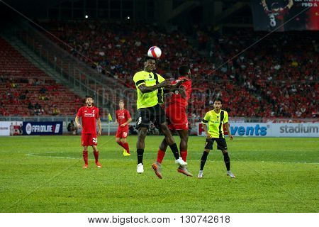 July 24, 2015- Shah Alam, Malaysia: Liverpool's Dovock Origi (27) challenges Malaysia's Bikana (5) to the ball in the friendly match. Liverpool Football Club from England is on an Asia tour.