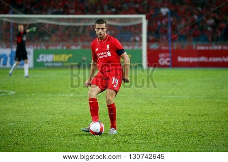July 24, 2015- Shah Alam, Malaysia: Liverpool's Jordan Henderson (14) passes the ball in the friendly match against the Malaysian team. Liverpool Football Club from England is on an Asia tour.