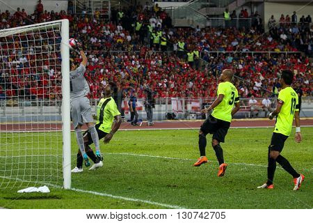 July 24, 2015- Shah Alam, Malaysia: Malaysia's goalkeeper Khairul Azhan catches the ball in a friendly match against Liverpool FC. Liverpool Football Club from England is on an Asia tour.