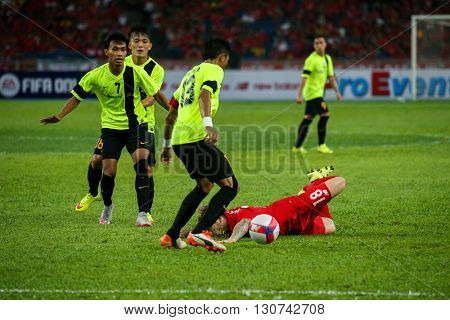 July 24, 2015- Shah Alam, Malaysia: Liverpool's Alberto Moreno (red) falls after a tackle in a friendly match against the Malaysian Team. Liverpool Football Club from England is on an Asia tour.