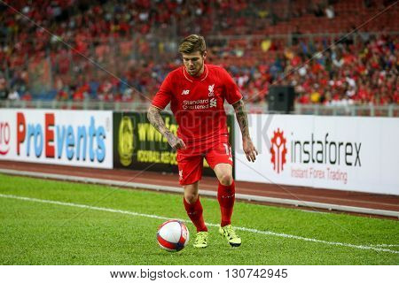 July 24, 2015- Shah Alam, Malaysia: Liverpool's Alberto Moreno dribbles the ball in a friendly match against the Malaysian Team. Liverpool Football Club from England is on an Asia tour.