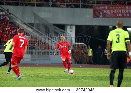 July 24, 2015- Shah Alam, Malaysia: Liverpool's Martin Skrtel (red) passes the ball in a friendly match against Malaysia. Liverpool Football Club from England is on an Asia tour.