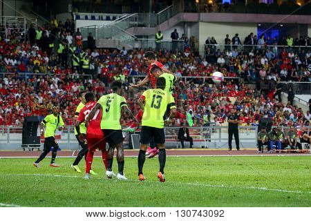 July 24, 2015- Shah Alam, Malaysia: Liverpool's players (red) challenges for the ball against the Malaysian team (green) in the friendly match. Liverpool Football Club from England is on an Asia tour.