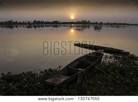 Old Wooden Canoe Fishing Boat Showing Vegetation Growth Within Boat Asia