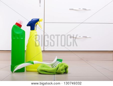 Cleaning Supplies And Tools On Floor