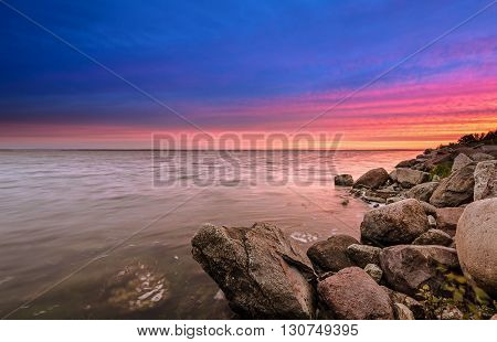 Stony coast of the Gulf of Puck sunset
