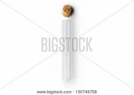Glass transparent test tube with cork above on white background