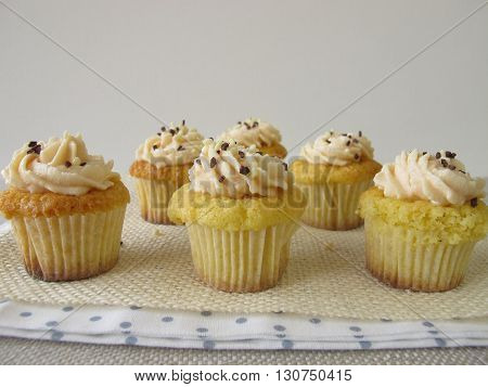 Gluten free cupcakes with fresh cheese cream and chocolate sprinkles