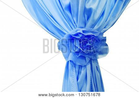 Blue silk curtains with bow isolated on white background.