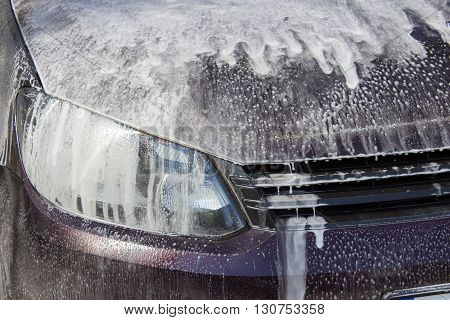 soapy foam on the surface of the car