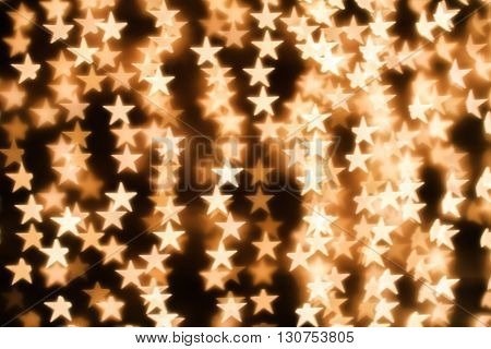 Blurring lights bokeh background of golden stars