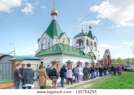 MOSCOW RUSSIA - May 01.2016: Queue parishioners to church to light cakes and eggs