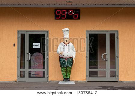 Moscow Russia - May 21 2016: Statue of restaurant chefs. Entrance to the coffee. Moisture Measuring Meter