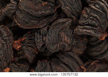 Organic Garcinia cambogia (Garcinia gummi-gutta) sun dried fruits. Macro close up background texture. Top view.