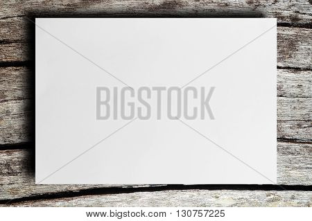 White blank paper on a wooden background
