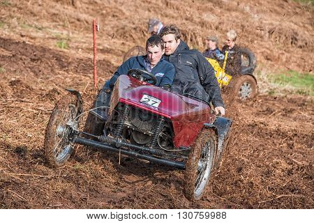 Worcester UK - March 13 2016 : Competitors take part in a hill climb to see who can drive their car furthest up a muddy hillside.