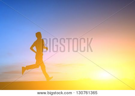 silhouette of youn man running in the sunset