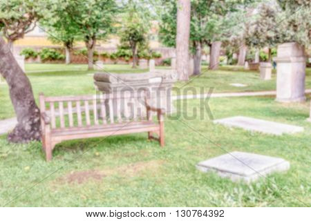 Defocused Background Of A Bench In The Park