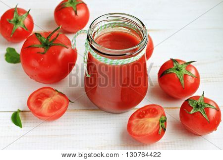 Fresh tomato juice smoothie glass jar, bright fresh tomato