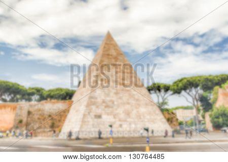 Defocused Background With Pyramid Of Cestius, Iconic Landmark In Rome