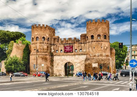 ROME - APRIL 24 2016 - People walking by the Porta San Paolo in Rome April 24 2016. Originally called Porta Ostiensis this gate is located at the beginning of via Ostiense which connects Rome and Ostia