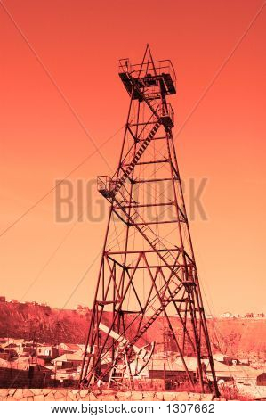 "Oil Derrick With ""Donkey"" Pump During Sunset"