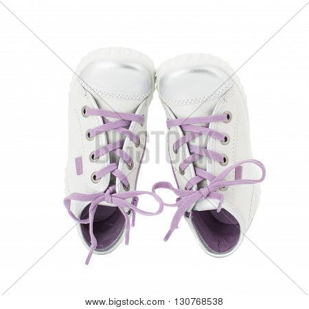 White leather sneakers with purple shoelace for girls. Isolated on a white background.