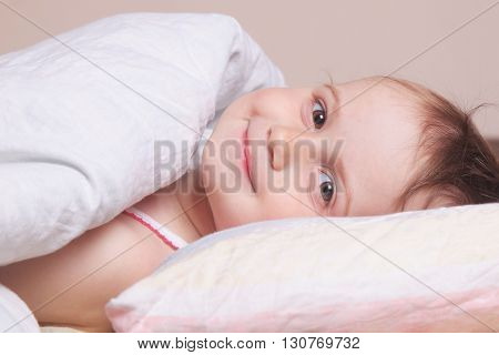 Beautiful baby girl getting ready for bed (childhood security family)