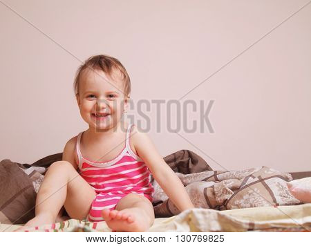 Happy baby girl getting ready for bed (Childhood security family)