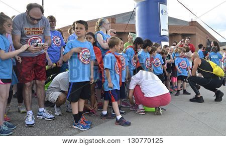 FARGO, NORTH DAKOTA-May 18, 2016: Kid runners line up for the Heroes Youth Run, an event at the Fargo Marathon  which also includes a dog, bicycle,  5K, 10K, half and full runs.