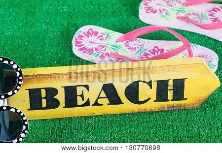 Direction sign with beach handmade and painted