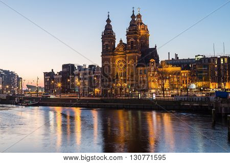 AMSTERDAM NETHERLANDS - 17TH FEBRUARY 2016: A view towards the Church of Saint Nicholas in Amsterdam in the morning.