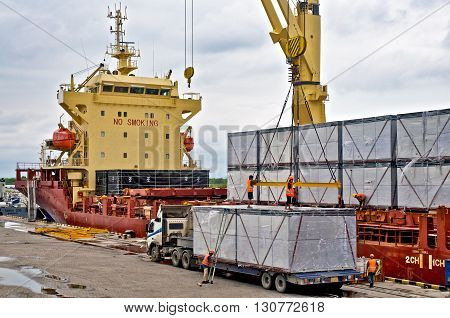 Loading cargo into the ship in harbor