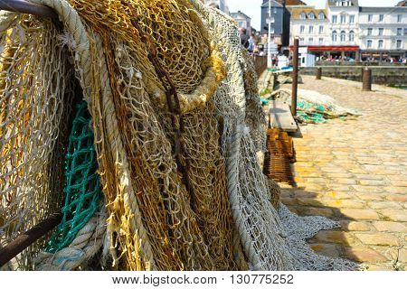 Fisherman's nets and old iron chain in old French harbor