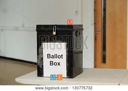 Ballot box with childrens' ABC blocks spelling out