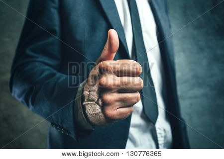 Gaining bosses approval businessperson gesturing thumb up for endorsing or approving employees work concept of success and good work in business.