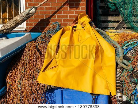 SCARBOROUGH ENGLAND - MAY 5: Trawlerman's protective oilskin smock and fishing gear in the harbour. In Scarborough England. On 5th May 2016.