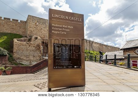 LINCOLN ENGLAND - MAY 3: The welcome and admission information sign standing at the entrance to Lincoln Castle. In Lincoln Lincolnshire England. On 3rd May 2016.