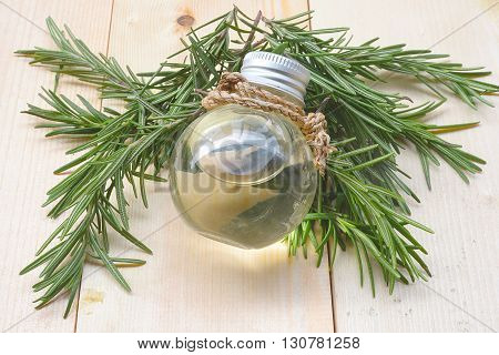 Rosemary essential oil in a glass bottle