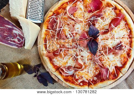 Fresh Hot Pizza With Parmesan Cheese, Jerked Meat, Basil And Tomatoes