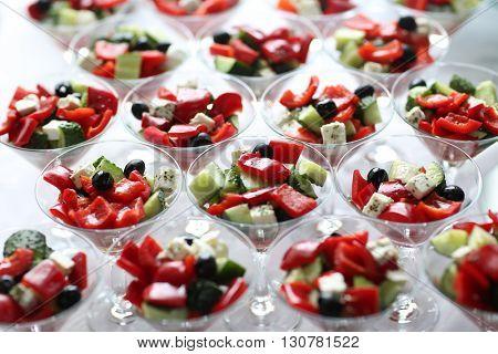 Fresh Greek salad in a bowls. Shallow depth of field